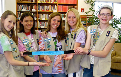 Girl Scouts FIRST LEGO League Team from New Mexico attends White House Science Fair, pictured with headband to help seniors with insomnia. L to R: Evelyn, Summer, Catherine, Lauren, and Haylee.  (PRNewsFoto/Girl Scouts of the USA)