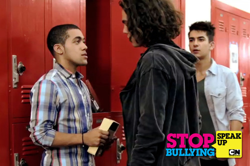 Teen actors from Cartoon Network's Dude, What Would Happen reenact a common bullying scene. CJ Manigo (far left) is being bullied by Jackson Rogow (center) while classmate, Ali Sepasyar, stands by and watches helplessly. Cartoon Network's STOP BULLYING: SPEAK UP campaign takes a new stand against bullying by teaching the bystander to act when they see someone being bullied. The initiative's website, www.StopBullyingSpeakUp.com, has resources for kids and adults to learn safe, effective ways to prevent and stop bullying.  ...