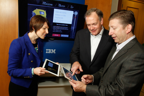 Michael Rhodin, Senior Vice President, IBM Software Solutions Group (center) explores new IBM Watson-powered apps with Jeff Margolis, CEO, Welltok (right) and Brooke Aguilar, VP, Global Business Development, Fluid (left). For the first time, IBM will open up Watson as a development platform in the cloud, for a worldwide community of software application providers to build a new generation of apps infused with Watson's cognitive computing intelligence. Jack Plunkett/Feature Photo Service for IBM. (PRNewsFoto/IBM) (PRNewsFoto/IBM)