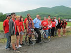 """Riders from the Eastern Band of Cherokee Indians (EBCI) and the Cherokee Nation join EBCI Principal Chief Michell Hicks (center, on bike) in a ceremonial send off for the annual 950-mile """"Remember the Removal"""" bike ride at the Kituwah Mound near Cherokee, N.C. on May 30, 2014. The 3-week ride from Georgia to Oklahoma commemorates the 1839 Trail of Tears. (Photo: Eastern Band of Cherokee Indians).  (PRNewsFoto/Eastern Band of Cherokee Indians)"""