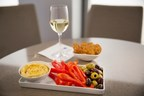 New afternoon and evening complimentary food offerings include fresh hummus with pita thins or pretzel crisps and assorted sides, including Greek olives and freshly sliced red bell peppers.