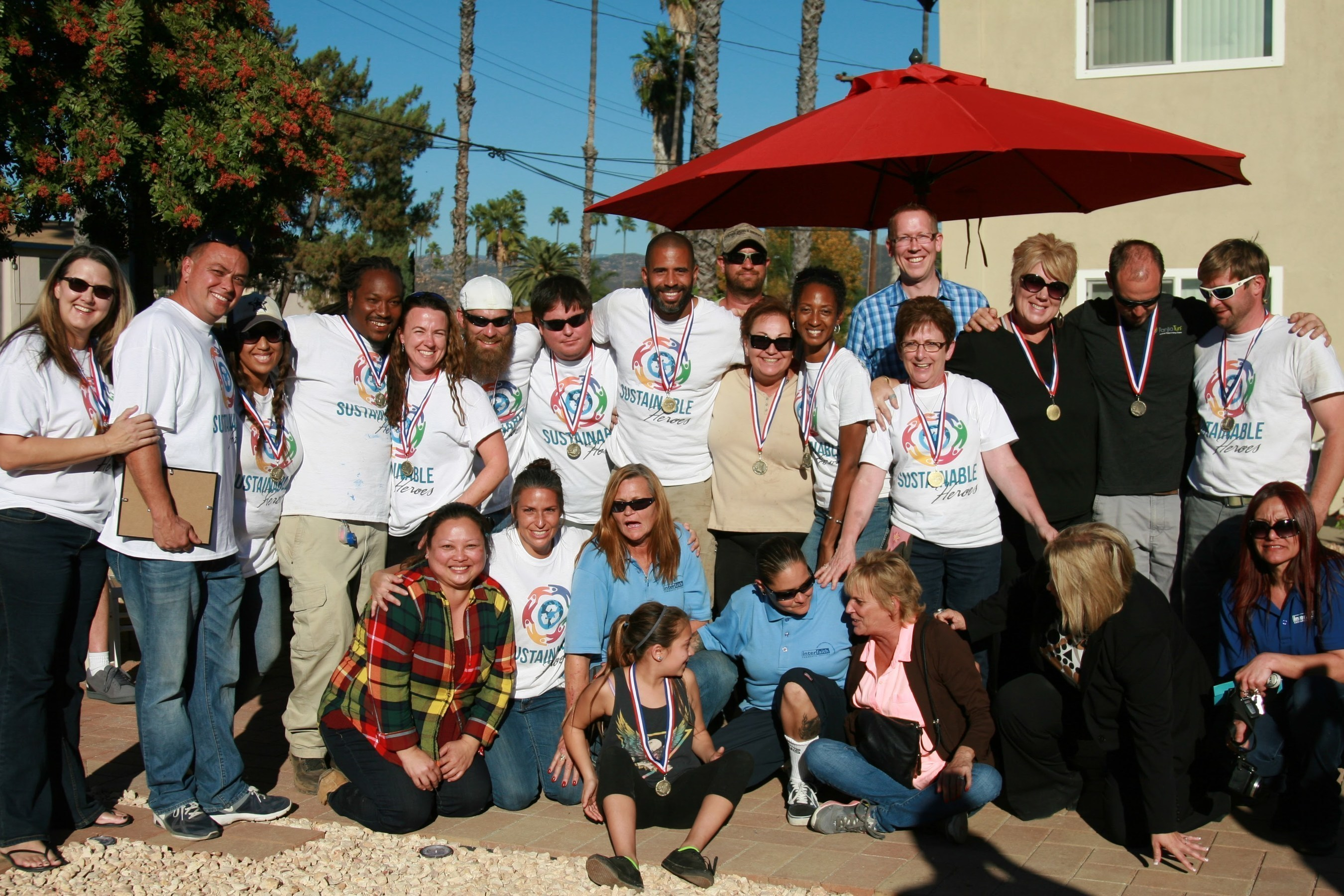 Sustainable Heroes Team Members with Interfaith Community Services partners at the Astor Street Gardens project in Escondido, California.