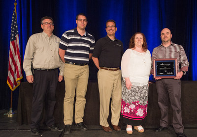 Accepting the American Gas Association's Safety Achievement Award on behalf of Eastern Shore Natural Gas Company, from left: Bill Hermstedt, Operations Project Coordinator; Nick Bishop, Project Engineer; Mark Parker, Engineer Manager; Marianne Coker, Gas Control Manager; and Solomon McCloskey, Senior Manager, Gas Pipeline Operations.