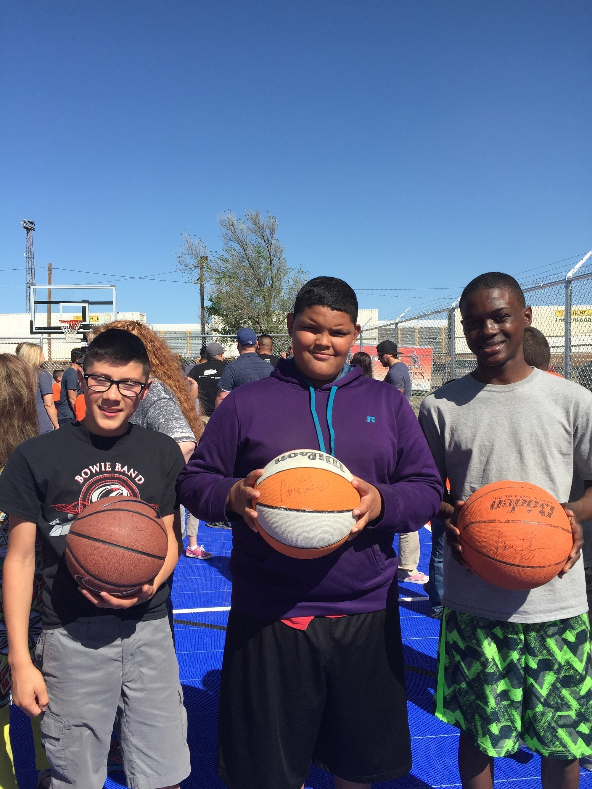 """Maverick"" Boys & Girls Club Amarillo members, Jose, Malachi, Toddrick express thanks for new DreamCourt, donated by WorldVentures Foundation and Nancy Lieberman Charities"
