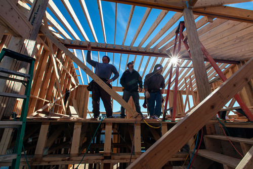 "Workers constructing a new home in Bethany Beach, Delaware. 84 Lumber launched its ""We Build American"" ..."