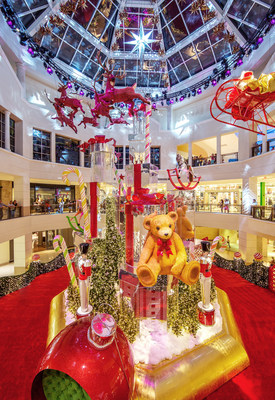 Aventura Mall's all-new Santa's Workshop is highlighted by mirrored gift boxes stacked 60 feet high and adorned with cuddly 10-foot teddy bears, classic English-style rocking horses, 12-foot tall toy soldiers, and 13-foot candy canes.