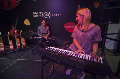 "Visitors interact with Casio's keyboard in the ""Guitar: The Instrument That Rocked the World"" exhibit at Liberty Science Center. (PRNewsFoto/Casio America, Inc.)"