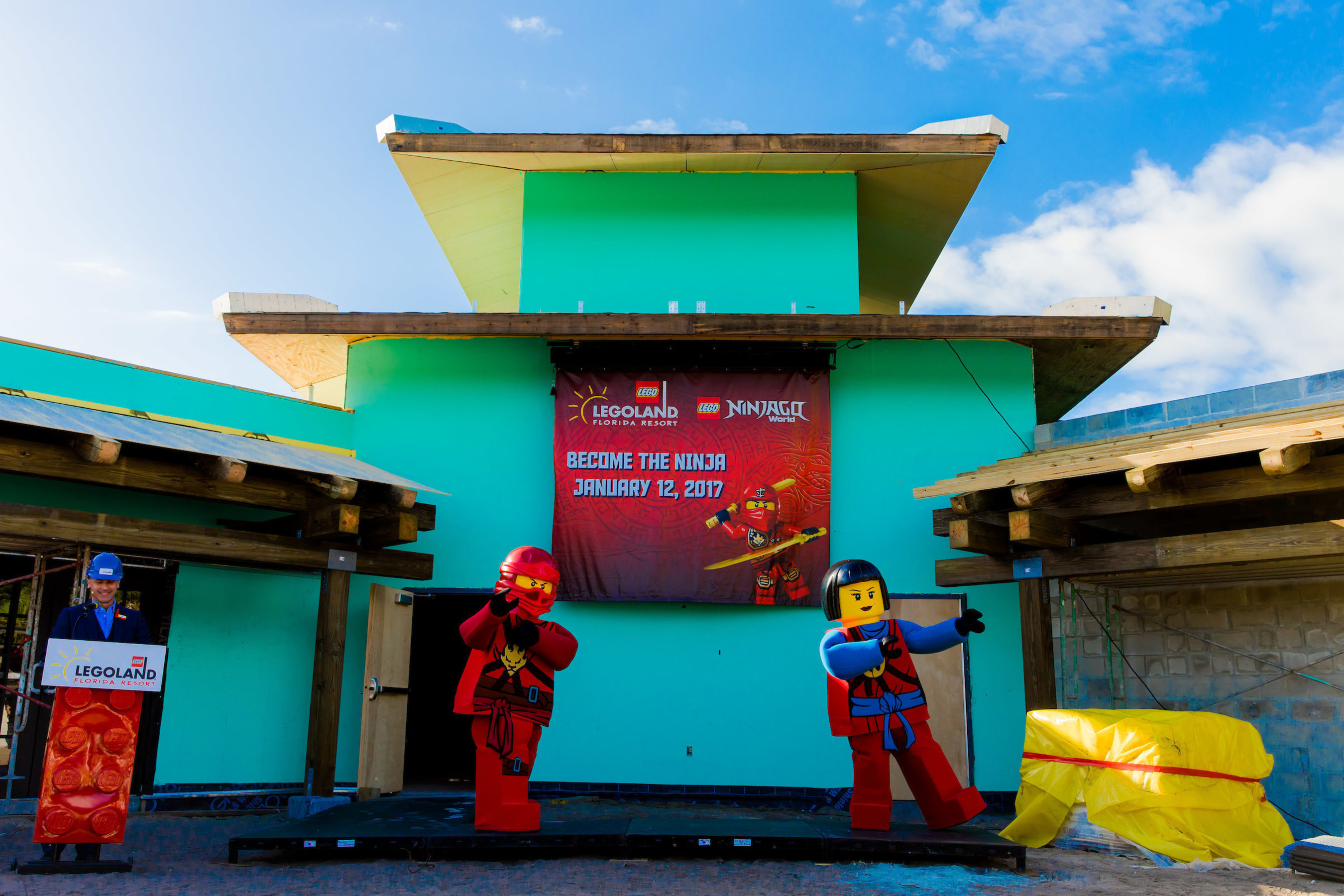 Brother-and-sister ninjas Kai, left, and Nya, helped reveal the grand opening date for LEGO NINJAGO World with Adrian Jones, general manager of LEGOLAND Florida Resort in Winter Haven, Fla.