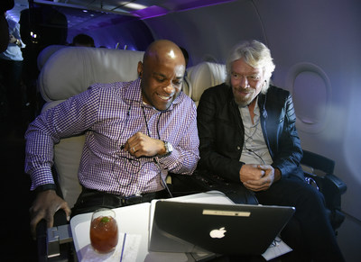 In this photo released by Virgin America Airlines, Virgin Group Founder Sir Richard Branson and Denver Mayor Michael Hancock participate in a live-streamed discussion at 35,000 feet onboard the airline's inaugural flight between San Francisco International Airport (SFO) and Denver International Airport Flight (DEN) - a new route that connects two of the nation's leading innovation economies, on Tuesday, March 15, 2016. To kick off the new business travel route onboard the inaugural flight today, the airline known for its modern and tech-forward service - including new, even higher speed in-flight WiFi, convened a live-streamed discussion at 35,000 feet on the future of entrepreneurship with partner LinkedIn, Virgin Group Founder Sir Richard Branson, Denver Mayor Michael Hancock and up-and-coming business leaders. (Photo by Virgin America/Bob Riha, Jr.)