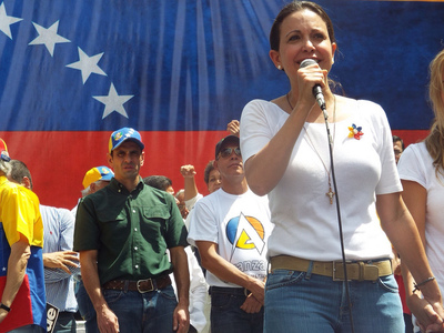Venezuelan Congresswoman Maria Corina Machado speaks at a pro-democracy rally. (PRNewsFoto/IFES)