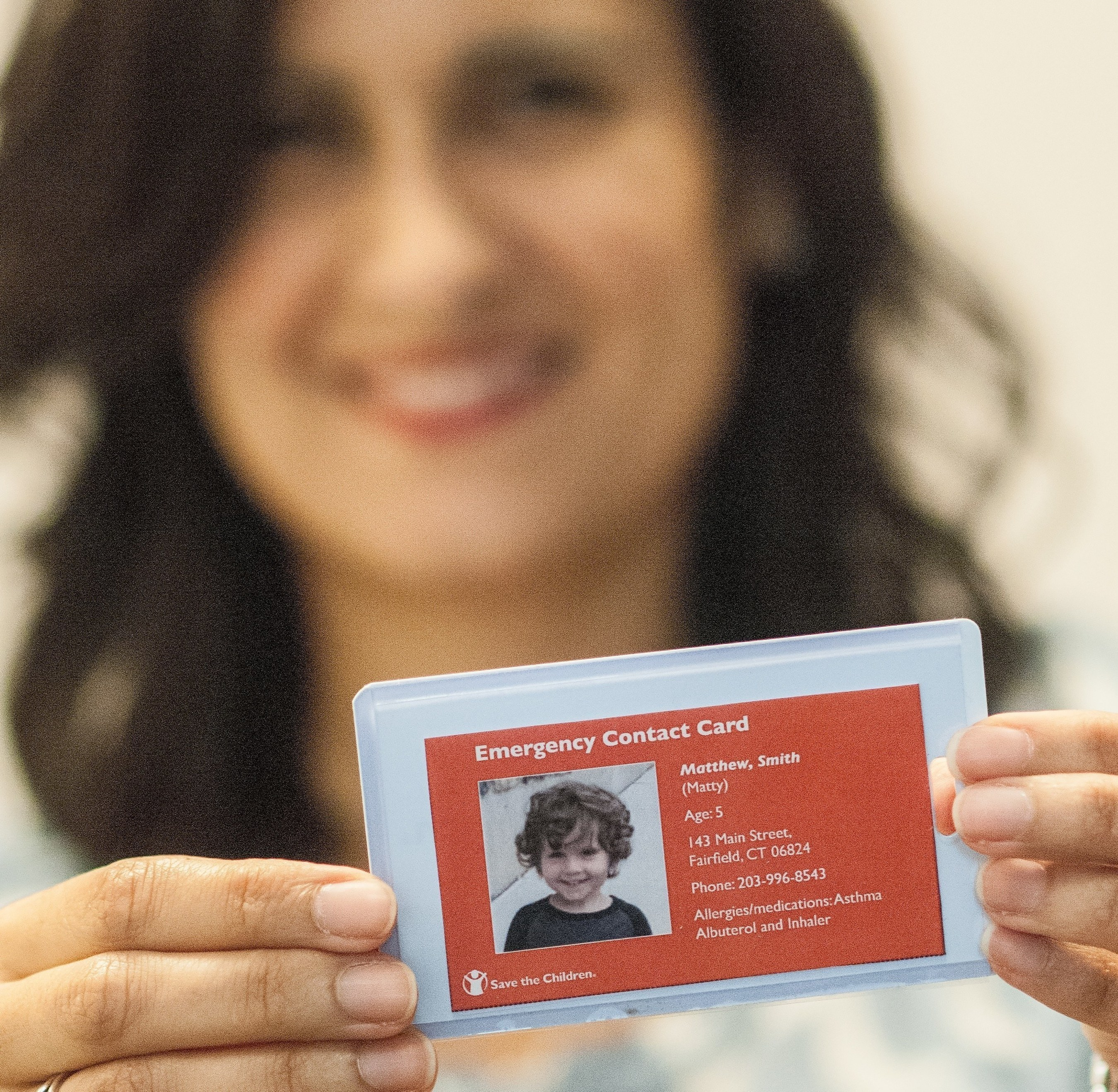 """Save the Children's """"Stay Connected"""" campaign calls on parents to create emergency contact cards. These can serve as a lifeline to children when disasters separate families. After Hurricane Katrina, there were 5,000 reports of missing children. Credit: Susan Warner/Save the Children"""