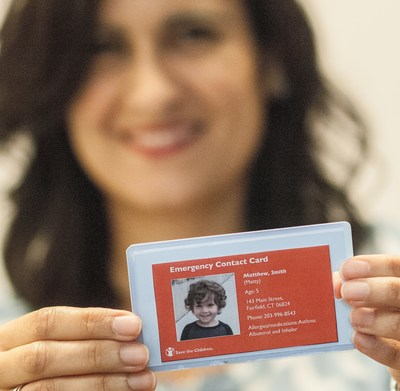 "Save the Children's ""Stay Connected"" campaign calls on parents to create emergency contact cards. These can serve as a lifeline to children when disasters separate families. After Hurricane Katrina, there were 5,000 reports of missing children. Credit: Susan Warner/Save the Children"