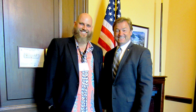 'Thrift Hunters' co-star and Thrifting with the Boys founder Jason T. Smith (left) with U.S. Sen Dean Heller (R-Nev.) during the Small Business Fly-in/Advocacy Day of the U.S. of eBay held in 2012. Smith will be talking with senators and U.S. representatives on April 30, 2014, about the issue of Internet sales tax as it applies to small-volume e-Bay sellers.  (PRNewsFoto/WorthPoint Corporation)