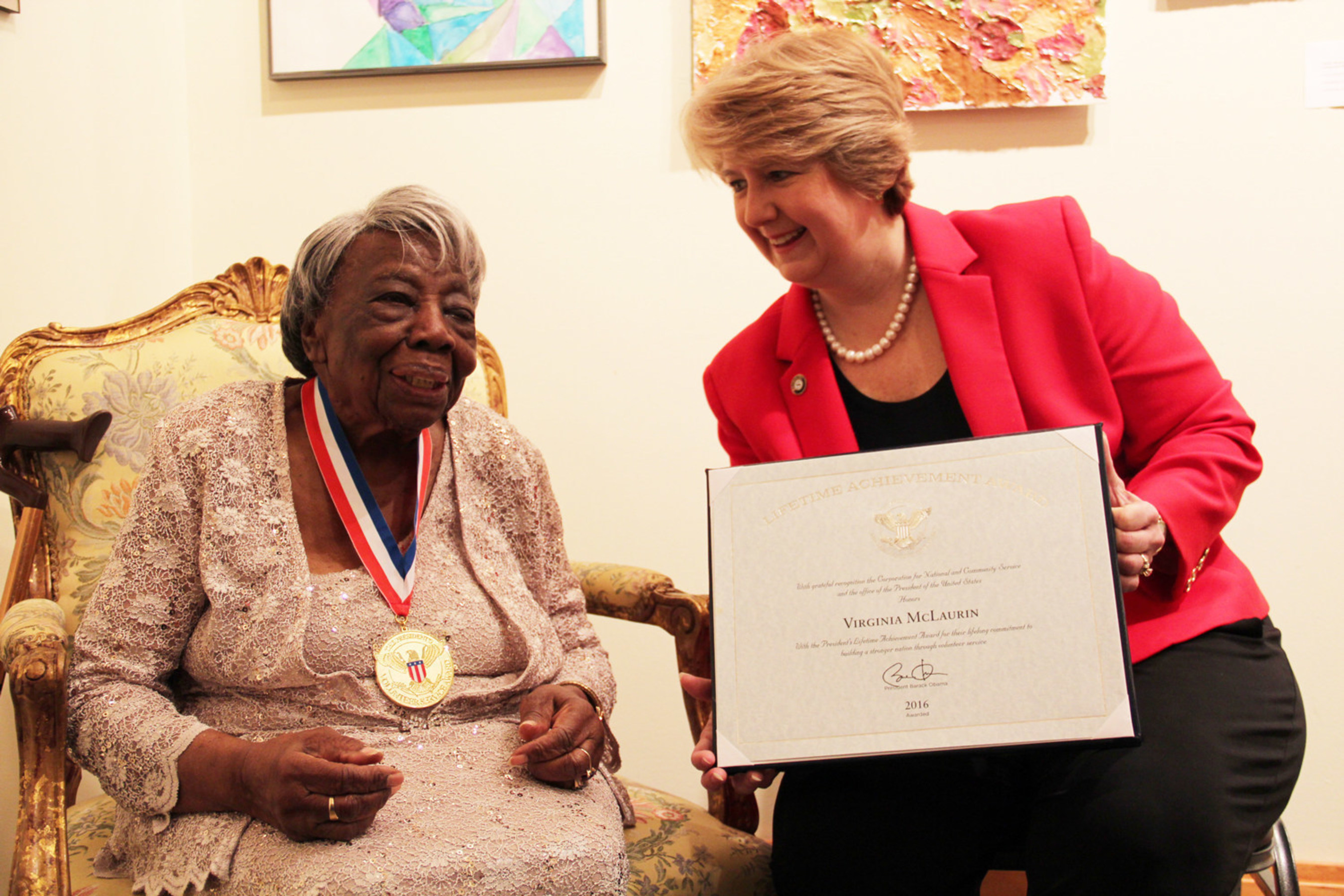 Wendy Spencer, CEO of the Corporation for National and Community Service, presents Ms. Virginia McLaurin, a Senior Corps volunteer, with the President's Volunteer Service Award for Lifetime Achievement in advance of her 107th birthday on March 12, 2016.