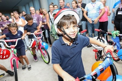 Boys and Girls Club of South Beach children are surprised with their new bikes for the holidays.
