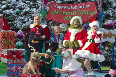 The Grinch and Max the Dog Present Betty White With The 'Who-Manitarian of the Year' Award as Universal Studios Hollywood Prepares to Ring in 19 Snow Filled Days of 'Grinchmas' with Tons of Real Snow, Celebrity Tree Lightings and Who-liday Cheer.  (PRNewsFoto/Universal Studios Hollywood)