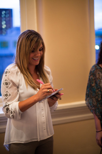 """Rock musician Grace Potter lends her pink autograph to a fan as she helps kick off the annual """"Ink It ..."""