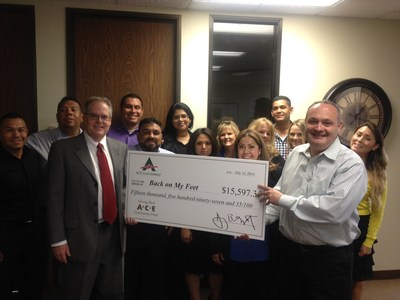 ACE employees present Back on My Feet Los Angeles with donation. (PRNewsFoto/ACE Cash Express)