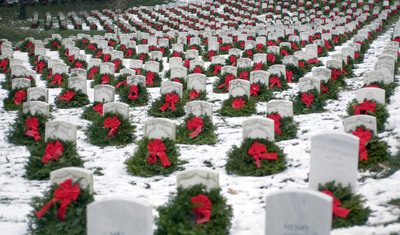 Each year thousands of wreaths are donated and placed at Arlington National Cemetery to remember, honor, and teach about the service and sacrifice of our veterans. (photo taken by James Varhegyi, courtesy of WreathsAcrossAmerica.org).  (PRNewsFoto/Wreaths Across America, James Varhegyi)