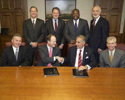 IBM, the University of South Carolina (USC) and Fluor Corporation today announced the formation of the Center for Applied Innovation. (seated from left) Mark Easton, VP, Industry Solution Sales, IBM; Cameron Art, General Manager of Application Management Services, IBM; Harris Pastides, President, USC; Gene Warr, Chairman of the Board of Trustees, USC (standing from left) David Miller, Director, Application Management Services North America, IBM; Andy Bernardin, Director of Enterprise Sales for South...