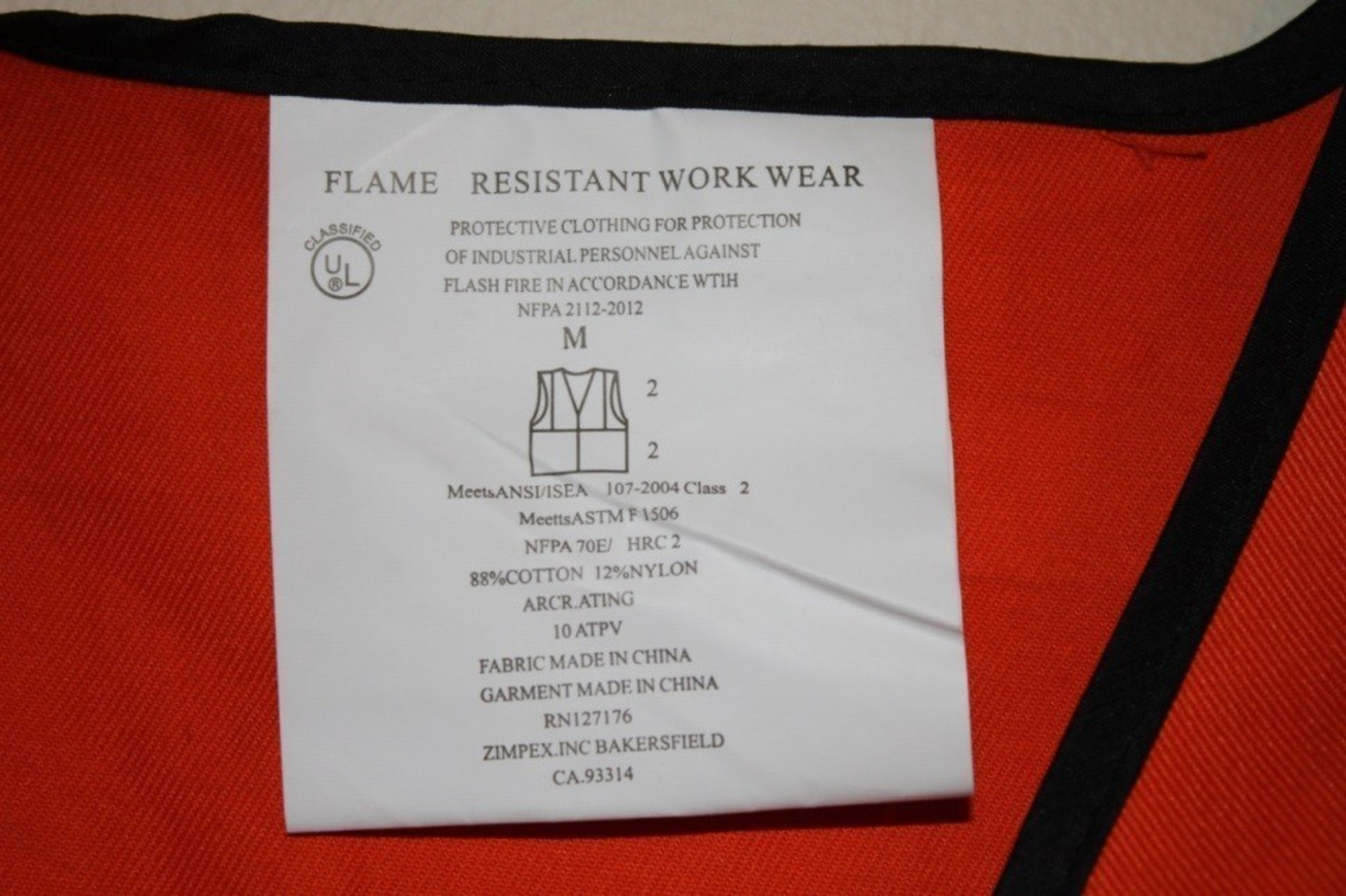 Picture of counterfeit UL label on collar of vest: