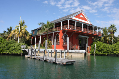 "The Boat House's most distinctive feature – and the source of its namesake - is an enchanting boat slip and lift area that serves as the highlight of the ground floor. ""When you come into the property at night in your boat, it's like returning to a hideout in a James Bond movie,"" said the current owner of the estate."
