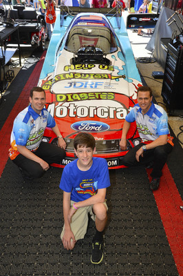 "Blake Lillicraf with Bob Tasca and Travis Hunt in front of the Motorcraft/Quick Lane Ford Shelby Mustang Funny Car. Blake was recognized as the winner of Ford Customer Service Division's ""Our Everyday Heroes"" Race Car Design Contest to benefit JDRF.  (PRNewsFoto/JDRF)"