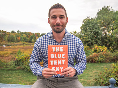 Brian Aitken, author of The Blue Tent Sky: How the Left's War on Guns Cost Me My Son and My Freedom, poses with his book in UpState New York.