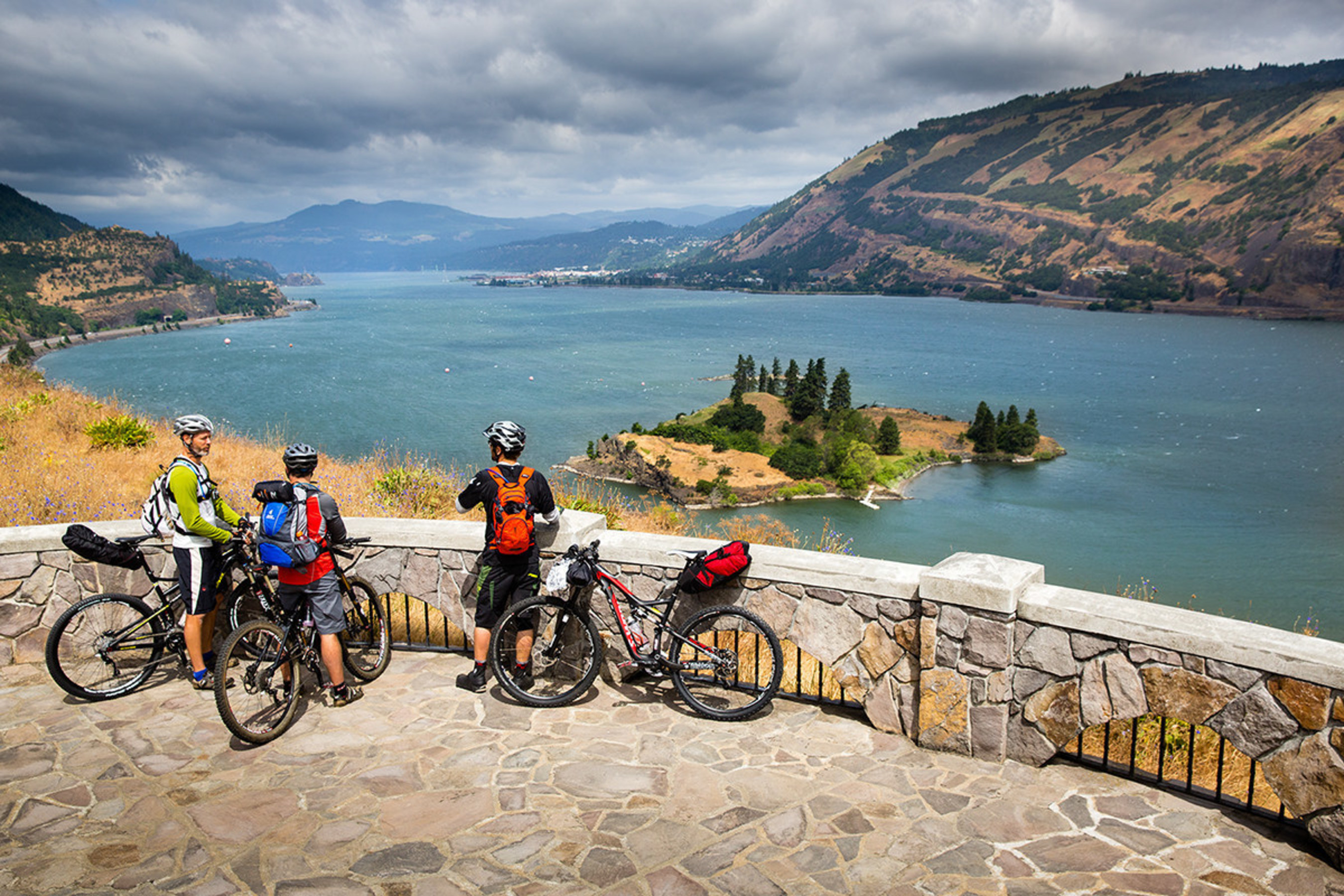 Bicyclists enjoy the view of the Columbia River on the Historic Columbia River Highway, celebrating its Centennial Anniversary