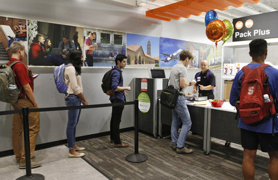Students at Stanford University drop off items at FedEx Office's Pack and Plus Counter