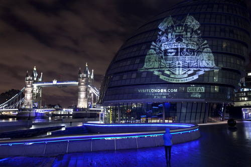 A crest was projected onto City Hall in central London today, Wednesday 12 November 2014, to mark the launch of visitlondon.com's new international search to find London's Official Guest of Honour. The winning guest will be invited to London in February 2015 and will have the unique honour of opening Tower Bridge, seeing a West End musical with Jessie J and visiting the Science Museum with renowned physicist Professor Stephen Hawking as well as many other experiences. Credit: David Parry/PAWire. (PRNewsFoto/www.visitlondon.com) (PRNewsFoto/WWW_VISITLONDON_COM)