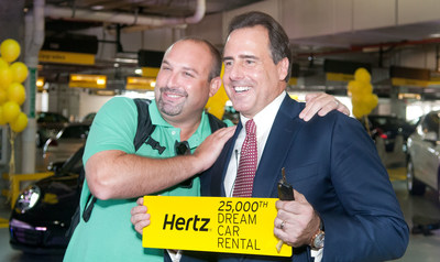 Mark Frissora, Hertz Chairman & CEO, right, celebrates 25,000th Dream Cars rental with customer Mike Yonover on Wednesday, Sept. 3, 2014 in Miami. (Mitchell Zachs/AP Images for Hertz)