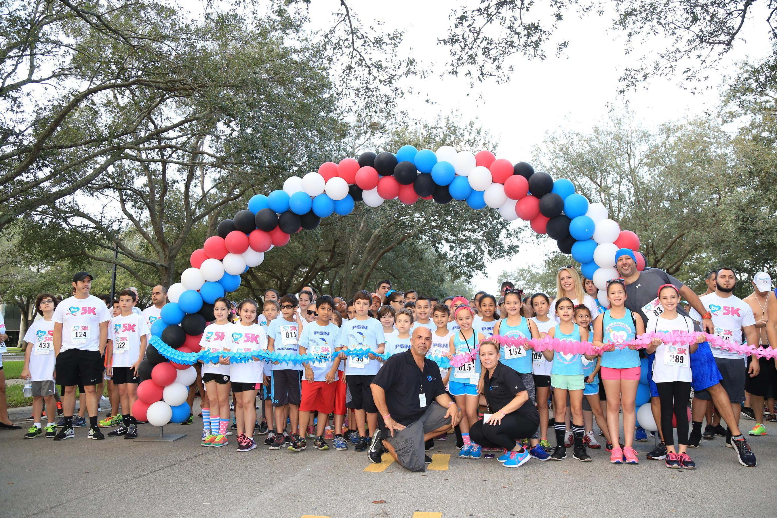 Breanna's parents, Jesus and Claudia Vergara, with race participants at the Breanna Vergara 5K & Color Run.
