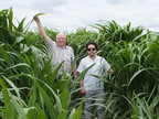 The picture shows 16 week old Giant King Grass which is 8 feet tall on the AGRICORP plantation in Nicaragua. Pictured are VIASPACE CEO Dr. Carl Kukkonen and Alejandro Ybarra-Rojas of AGRICORP.   (PRNewsFoto/VIASPACE Inc.)