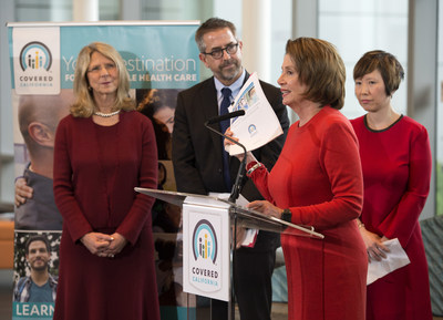 At a press conference at UCSF Benioff Childrens' Hospital San Francisco, House Democratic Leader Nancy Pelosi holds a Covered California report released today that highlights the vital treatment tens of thousands of Californians have received under the Affordable Care Act. At far left is Diana Dooley, Secretary of the California Health and Human Services Agency and in the middle is Covered California Executive Director Peter V. Lee. At far right is UCSF MD Stefanie Ueda.