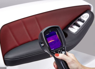 The new heated armrest from Yanfeng Automotive Interiors is based on the principle of panel heating. The thermal imaging camera allows us to see the heat generated. (PRNewsFoto/Yanfeng Automotive Interiors) (PRNewsFoto/Yanfeng Automotive Interiors)
