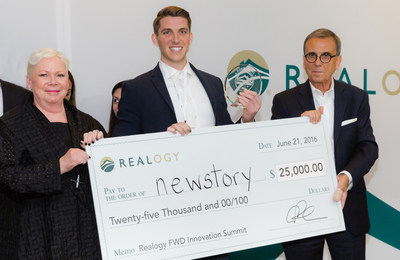 New Story co-founder and CEO Brett Hagler (center) accepts the $25,000 grand prize at the 2016 Realogy FWD Innovation Summit from Realogy executives Alex Perriello (right) and Sherry Chris (left).