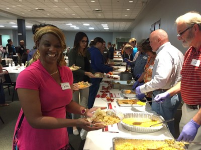 A warrior is all smiles as the food is served by volunteers at a Thanksgiving dinner event hosted by Wounded Warrior Project and Christ's Church in Jacksonville, FL.