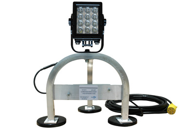 The versatile WAL-M-LED60-120 magnetic mount LED work light from Magnalight comes with a three leg aluminum mount fitted with three 200 lbs grip magnetic feet that makes it ideal for industrial applications, maintenance, cleaning and servicing duties, large open space areas and any area where metallic surfaces provide opportunity for mounting. This unit is composed of a 60 watt LED Light emitter producing 5,556 lumens and is capable of creating 350'L X 270'W of work space illumination.  (PRNewsFoto/Larson Electronics)