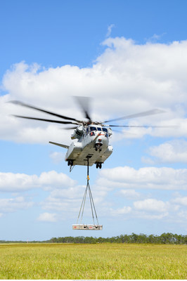 The CH-53K King Stallion helicopter achieves its first flight with an external load at Sikorsky's Development Flight Test Center in West Palm Beach, FL.