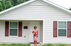 Ms. Joubert and her daughter have a safe place to live thanks to the HELP grant from FHLB Dallas and IBERIABANK which assisted with her closing costs on their Habitat for Humanity home. (PRNewsFoto/Federal Home Loan Bank of Dallas)