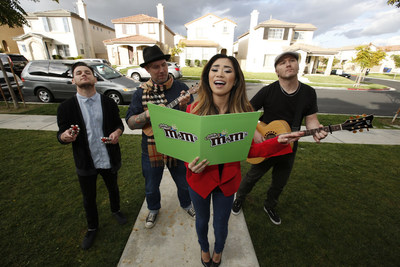 (December 18, 2014) Jessica Sanchez, celebrated singer and finalist on American Idol Season 11, spreads some sweet holiday cheer with the help of M&M'S(R) Crispy. Sanchez returned to her hometown of Chula Vista, CA, to surprise fans with holiday caroling and a special delivery of M&M'S(R) Crispy, which is returning to store shelves this month after a 10-year hiatus, thanks to a vocal fan base who pleaded for its return. (Photo by Christy Radecic/Invision for Mars Chocolate North America)/AP Images)