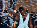 Lupita Nyong'o celebrates her Oscar win in Fred Leighton gold jewelry.  (PRNewsFoto/LoveGold)