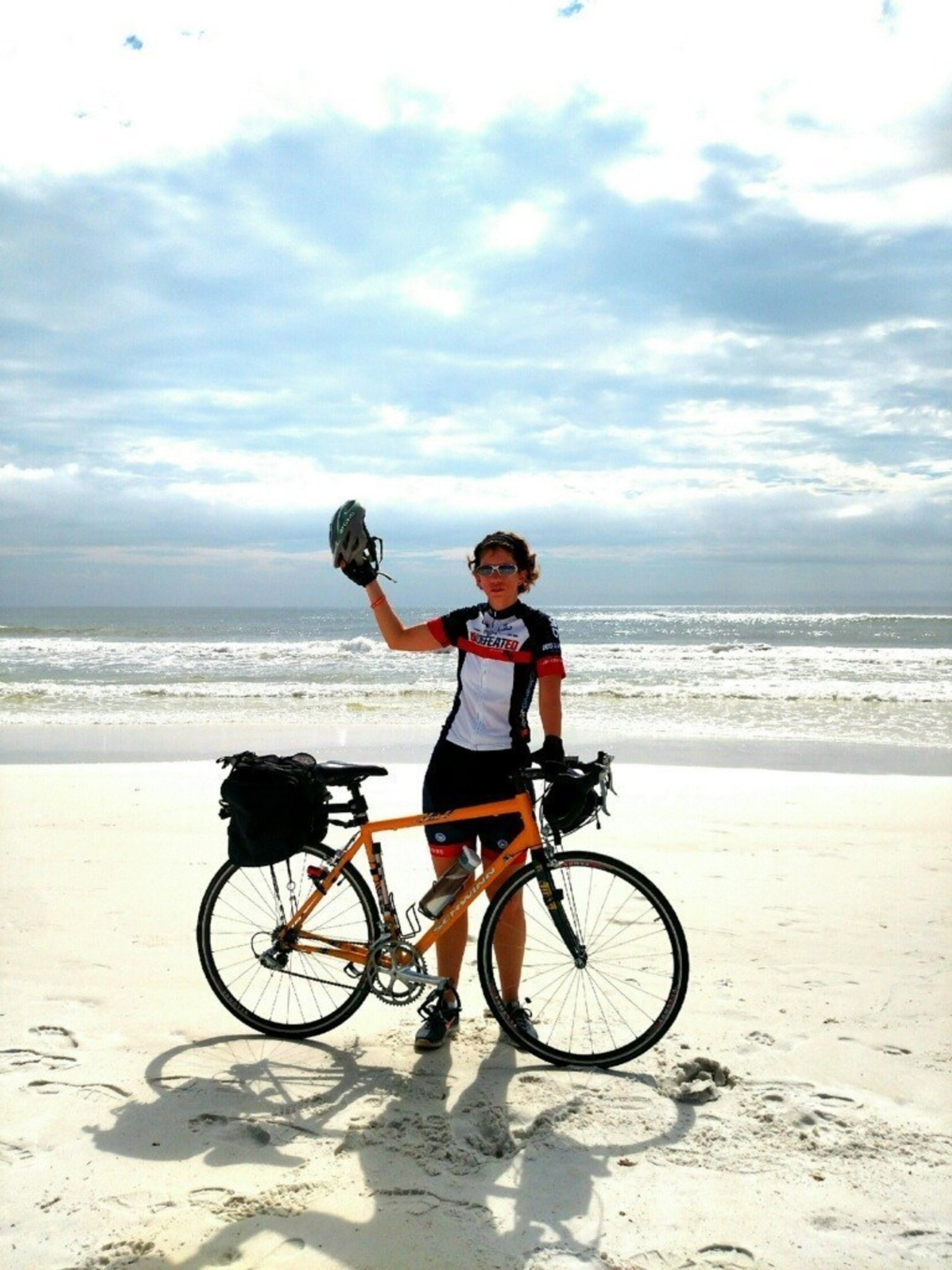 Patricia Waiwood and her bike at the end of her cross-country ride to Eglin AFB in Florida