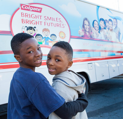 Two children receive free dental screenings in Colgate's Bright Smiles, Bright Futures mobile dental van.