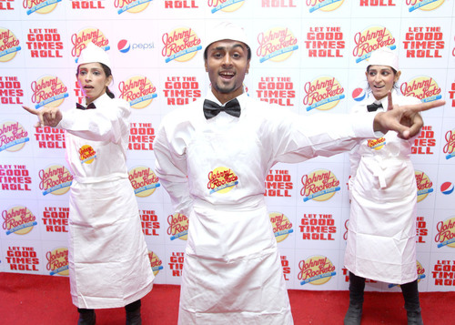 Johnny Rockets servers welcome guests at the new Karachi restaurant. (PRNewsFoto/Johnny Rockets) ...