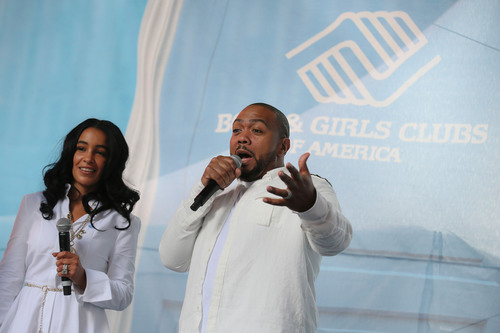 """Music mogul Timothy (Timbaland), center, and Monique Mosley issue a #GreatFutures $1 Million Match Challenge through their Always Believing Foundation at Boys & Girls Clubs of America's launch of the Great Futures Campaign to call attention to the critical role of out-of-school time for kids, Thursday, July 31, 2014, in New York. BGCA took over Times Square to """"redefine the opportunity equation"""" and garner support for after-school and summer programs that empower youth toward success. (PRNewsFoto/Boys & Girls Clubs of America) (PRNewsFoto/BOYS _ GIRLS CLUBS OF AMERICA)"""