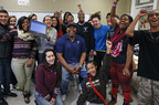 "Former Chicago Bears player James ""Big Cat"" Williams surprised Alcott College Prep senior Kim Perez and the rest of her classmates when he delivered a new laptop on Thursday in Chicago. Kim was one of 14 Chicago Public High School students to win a new laptop through the ""Get Schooled, Get Connected Challenge"" presented by Comcast Internet Essentials."