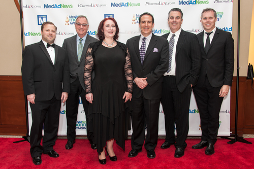 Dan Becker and Christiane Truelove of Med Ad News (left) congratulate AbelsonTaylor team for multiple awards won at 2014 Manny Awards. (PRNewsFoto/AbelsonTaylor)