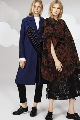 Model left wears Isa Arfen pants, Undercover coat. Model right wears Simone Rocha cape and dress.